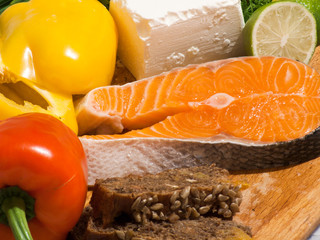 Ingredients for cooking salmon steak with cheese and pepper