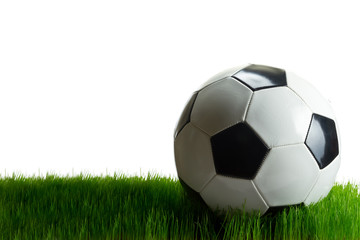 Soccer ball on the grass isolated on white