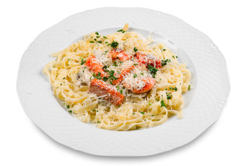 pasta with slice of salmon fish and parmesan, on white plate, is