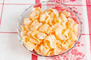 Tasty potato chips on a plate