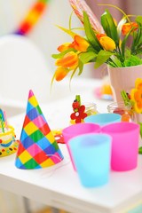 Closeup on table decorated for baby birthday celebration