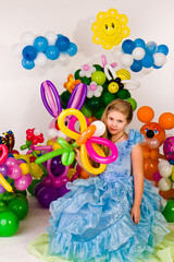 Beautiful little girl in balloon forest