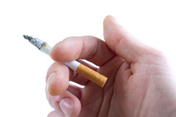 Cigarette in hand, isolated on white