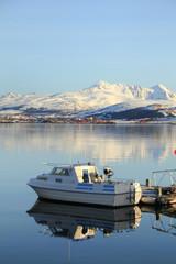 small boat mirroring with  Lofoten mountain