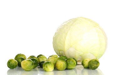 Fresh brussels sprouts and green cabbage  isolated on white