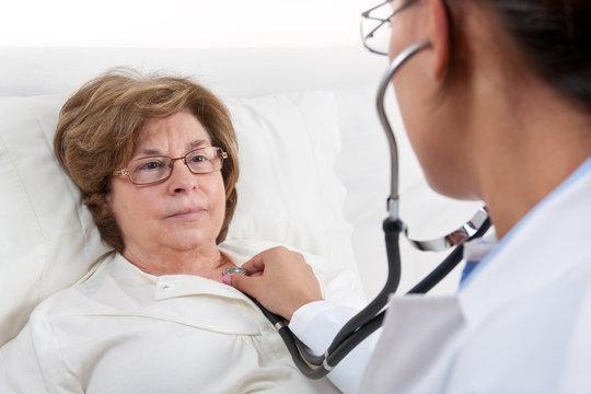 Doctor examining senior patient