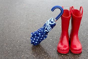 Red rain boots and umbrella