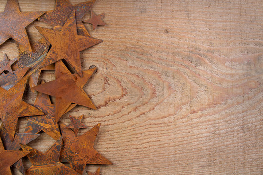 Rusty stars on a wooden background