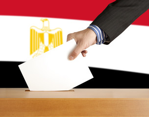Hand with ballot and box on Flag of Egypt