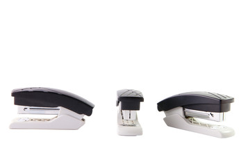 Composition of three identical office staplers