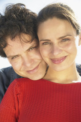 Close up portrait of couple hugging
