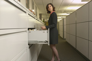 Portrait of businesswoman looking through files
