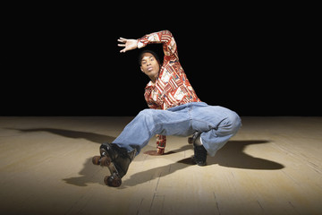 Portrait of man dancing on roller skates
