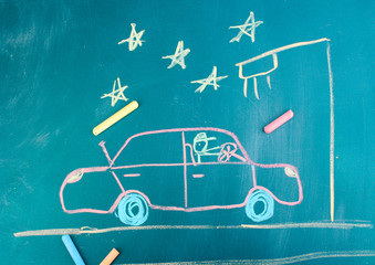 Car on road, child's drawing with chalk