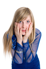 Shocked or surpised young woman with long blond hair, covering h