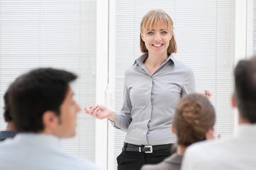 Businesswoman at presentation meeting