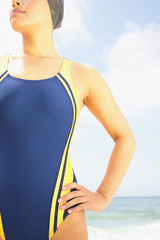 Midsection of woman in swimming suit