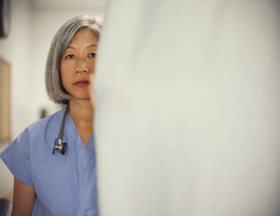 Mature female doctor posing