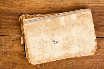 Antique book on wood background