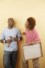 Couple with picture and hammer