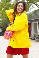 Portrait of woman wearing raincoat