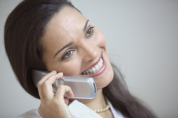 Close up of businesswoman talking on cell phone