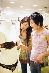 Two women shopping for lingerie
