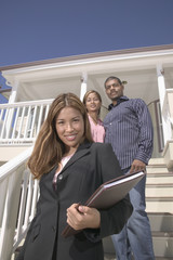 Portrait of realtor with couple