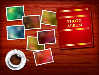 Wooden table, album, photos, coffee - place for your text