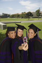 Female graduates taking self portrait