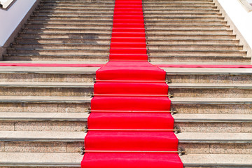 Red carpet way on staircase