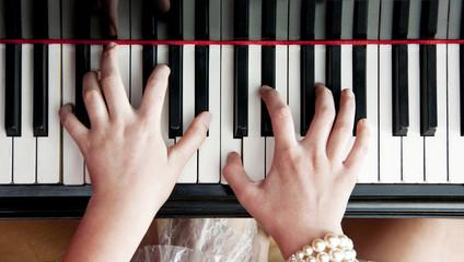 Hands on piano keys