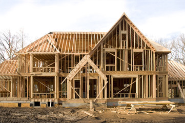 McMansion type house under construction in framing phase