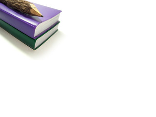 ○ Two littTwo note book and wooden pencil on white background.