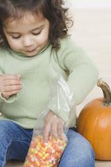 Little girl eating candy corn