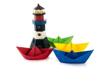 colorful paper boats with lighthouse
