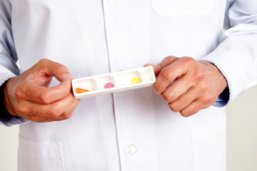 Male Doctor Hand Holding Pills