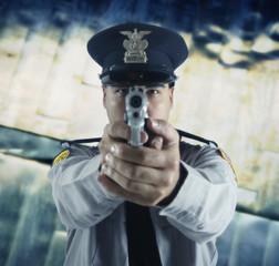 Male police officer aiming gun