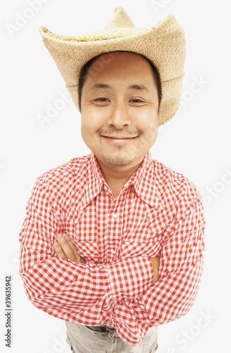 26679d5a026d7 Studio shot of Asian man wearing cowboy hat
