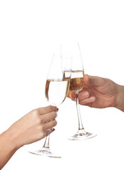 glasses of champagne  in hands on white  background