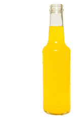 Glass bottle of orange soda isolated on white
