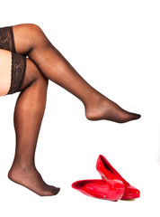 Woman with stockings and red shoes infront of her