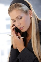 Businesswoman concentrating on phone call