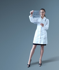 Future of medicine. Sexy female doctor with holographic sheet.
