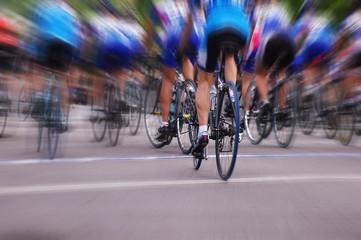 Blurred professional bike racers in a road race