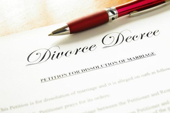 closeup of a divorce decree document with pen
