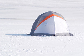 Single color tent in snow desert