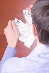 Man tore newspaper
