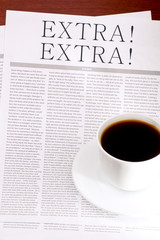 Newspaper EXTRA and a cup of coffee