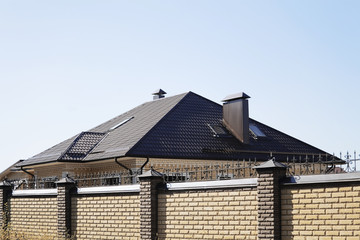 Roof and pipe of a modern apartment house in suburban settlement